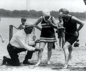 Colonel C.O. Sherrill, Superintendent of Public Building and Grounds issued an order that bathing suits at the Tidal Basin bathing beach must not be over 6 inches about the knee.  Bill Norton, the bathing beach policeman, measuring the distance between the knee and the bathing suit in the summer 1922.  United States Library of Congress's Prints and Photographs division under the digital ID cph.cph.3b45864.   http://commons.wikimedia.org/wiki/File:Col._Sherrell,_Washington_bathing_beach.jpg